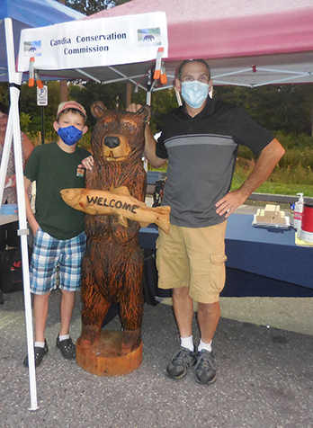 L to R: Remy Alff, the 2019 Barry Conservation Camp winner, the bear, and Leon Austin, the artist who carved the bear