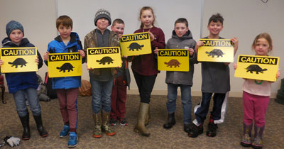CCC KIDS club helped Mrs. Lindsey paint the Critter Crossing signs